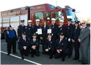 Legislator Ellen W. Birnbaum with members of the Vigilant Fire Company including Chief Josh Forst and Fire Captain Laurence Jacobs