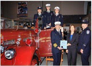 Legislator Ellen W. Birnbaum with members of the Manhasset-Lakeville Fire Department including Chief Mark Kiess