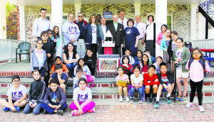 JFK Elementary School students and staff with members of the Park District and the Historical Society (from left, back row): Great Neck Park District Superintendent Jason R. Marra, JFK Principal Ronald Gimondo, Park Rec Aide Dana Gianone (sitting below Gimondo), Park Commissioner Daniel M. Nachmanoff, Assistant Principal Kathleen Murray, Steppingstone Park Supervisor Curtis Phillips, Park Commissioner Frank S. Cilluffo, Historical Society Treasurer Jay Mancus, member Chris Soto and President Alice Kasten, Park Commissioner Robert A. Lincoln, Jr., and Assistant Superintendent of the Great Neck School District Kelly Newman (Photos by Michele Siegel)