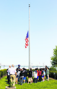 Before making the official donation, the students watched Park Supervisor Curtis Phillips raise the flag.