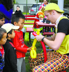 A balloon artist captivated the children.