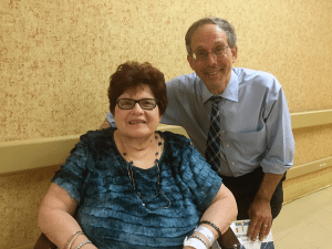 Pictured at the festivities are resident Francine McGovern and Rabbi Michael Klayman.