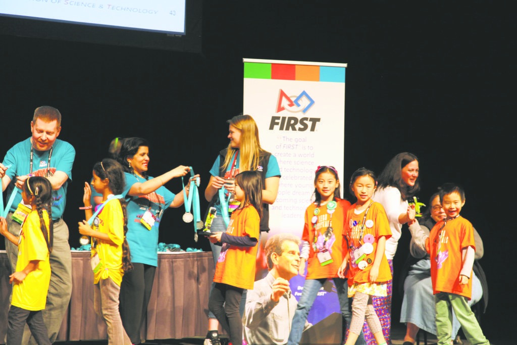 Team Lego Crystals receive their medals.