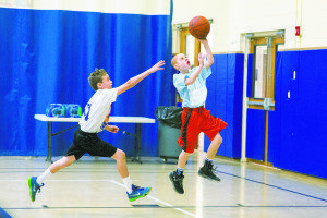At right, Braden Sosnick of the Sid Jacobson JCC Maccabi Team shoots.