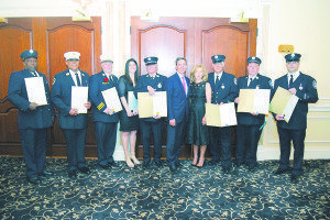Martins (right of center) and Village of Flower Hill Mayor Elaine Phillips (fourth from right) are pictured with, from left: Firefighter Samuel Brown III (25 years of service), Department President Konata Ragin (25 years), Second Deputy Chief Brian Stone (25 years), Tina Romeo-Karen (posthumously for Firefighter Charles Karen, 25 years), Ex-captain John Kadnar (50 years), Firefighter Daniel Garcia (25 years), Ex-captain Sean Fagan (25 years) and Firefighter Sevan Yekhpairian (25 years). Firefighter Brian Kenny  (50 years) and Ex-captain Rudy Baranco (25 years) are not pictured.