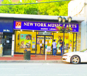 Parents wait to pick up their children from lessons outside New York Music & Arts.