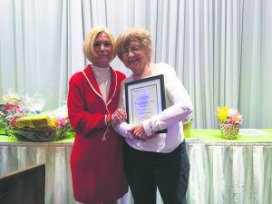 Great Neck resident Sandra Kendall (right) received an award from NCJW Lakeville Section, presented by CeCe Friedman.