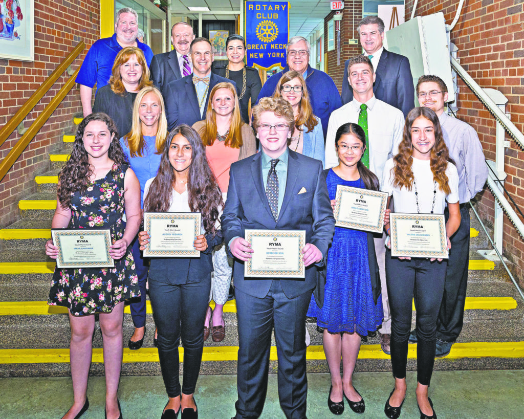 Rotary honorees (from left, front row): North Middle students Maya Garfinkel and Audrey Yeganeh, and South Middle students Derek Delson, Joelle Siong Sin and Valerie Deligiannis; (second row): North Middle faculty advisors Lauren Ferguson and Elizabeth Oggeri, and South Middle faculty advisors Kristin Klein, Brian Pernice and Daniel Isaac; (third row): Superintendent of Schools Dr. Teresa Prendergast, North Middle Principal Gerald C. Cozine, South Middle Principal Dr. James Welsch and Assistant Superintendent–Secondary Dr. Stephen Lando; (back row): Rotary Liaison Roger Chizever, Rotary President Leonard N. Katz and Town of North Hempstead Councilwoman Anna Kaplan (Photo by Jeff Barlowe)