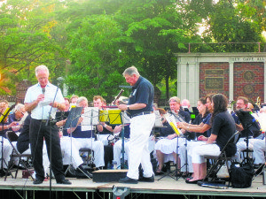 Past Rotary President Phil Raices  introduces a number at the Summer  Community Band program.