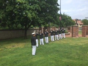 Members of the Firing Team from USMMA in Kings Point prepare to fire volleys in remembrance of the fallen soldiers.
