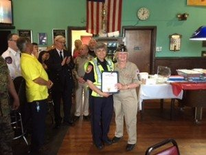 American Legion Post #160 Commander and GN Memorial Day Parade Chairperson Louise McCann honoring Nassau County Auxiliary Police Officer Maria D'Amelio for all her efforts in police control during the parade