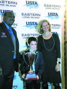 Jordan Reznik received his award from Daniel Burgess, president of USTA Long Island region, and Laura Curran, Nassau County Legislator.