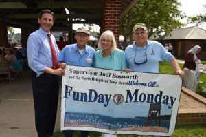 Supervisor Judi Bosworth and Town Clerk Wayne Wink are with two seniors at a Funday Monday last summer.