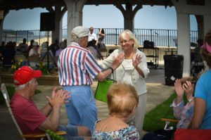 Supervisor Judi Bosworth dances with a senior at last year's Funday Monday.