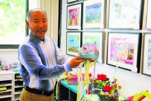 Teacher Tony explains this mixed-media jellyfish created at New Color Arts Academy.