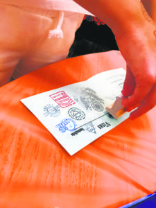 """A student stamps her """"passport"""" in Korea."""