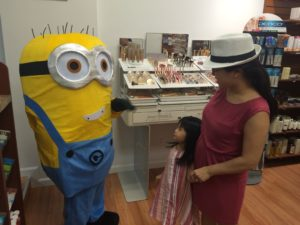This child follwed the minion, who was planning to take a break in the store.