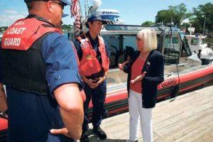 Supervisor Judi Bosworth speaks with members of the U.S. Coast Guard.