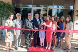 Everyone was so excited at the ribbon cutting, especially Chabad's Rabbi Yoseph  Y. Geisinsky (center).
