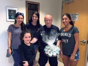 From left: Kayla Schwartz, Rivkah Ezagui, Sydney Schwartz and Ashley Yadidi delivered goodies to an officer at the Lake Success Police Department.