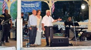 From right: Metropolitan Commercial Bank Vice President and Relationship Manager Ralph Ventura addressed the crowd with Village of Great Neck Plaza Mayor Jean Celender and Trustee Gerald Schneiderman at a recent concert sponsored by the bank.