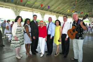 From left: Councilwoman Lee Seeman, Councilwoman Viviana Russell, Town Clerk Wayne Wink, Supervisor Judi Bosworth, Councilman Peter Zuckerman, Councilwoman Anna Kaplan, Receiver of Taxes Charles Berman and FunDay Monday performer Richard Mattes of Sweet Lorraine