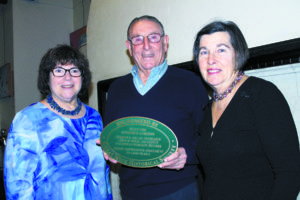 Great Neck Historical Society President Alice Kasten (left) and Plaque Program Chair Joan Wheeler presented a plaque to Kenwood Gardens co-op President Bruce Funk.