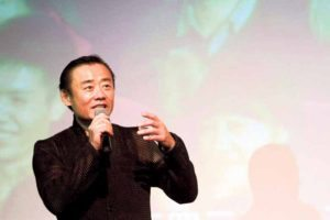 Zhou speaking at Flushing Town Hall in June