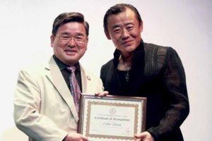 Councilman Peter Koo presenting a Certificate of Recognition to Zhou