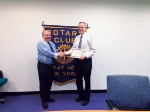 Rotary Club President Leonard N. Katz (left) presented Yechiel Marcus of the Jaffa Institute with a Certificate of Appreciation.