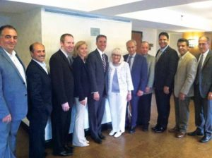 Senator Jack M. Martins (fifth from left), Supervisor Judi Bosworth and Great Neck Mayor Pedram Bral are pictured with community leaders and residents at the anti-Semitism forum.