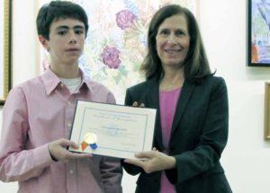 Legislator Ellen W. Birnbaum and Shelter Rock Public Library finalist Christopher Piccirillo.