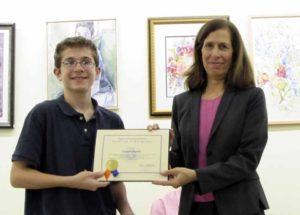 Legislator Ellen W. Birnbaum and Shelter Rock Public Library finalist Lawson Everitt.
