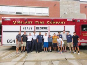 The Vigilant firefighters helped Erin Lipinsky (center) raise money for the Special Olympics.