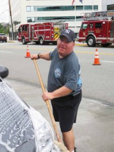 Lipinsky washes a car to raise money.