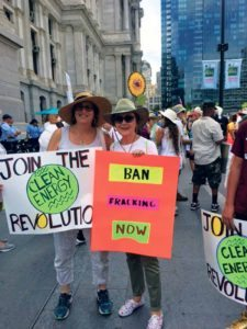 Patty Katz, VP of Reach Out America, and Sandie Salat, green committee chair, at the March for a Clean Energy Revolution