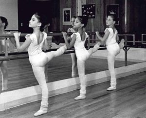 Three students at the barre of the original GNSD studio in the 1980s