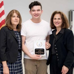Great Neck student Jonathan Arevalo, who earned a $125 scholarship from Nassau BOCES Barry Tech this year, is flanked by Barry Tech Principal Laurie Harris and Nassau BOCES Board Vice President Susan Bergtraum.