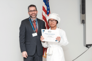 Nassau BOCES Barry Assistant Principal Dr. William Poll (left) congratulates Kim Sanae on being named Student of the Quarter.