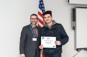 Nassau BOCES Barry Assistant Principal Dr. William Poll (left) congratulates Jonathan Arevalo on being named Student of the Quarter.