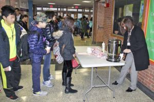 South Middle students line up for a cup of cocoa during the annual Cocoa Sale fundraiser. (Photo by Deidre Elzer-Lento)