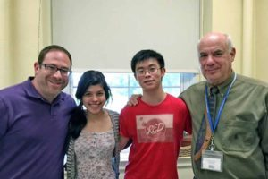 From left: North High NCTE winners Rachel Berkower and David Liu are flanked by English Teacher Scott Honig and Principal Bernard Kaplan.