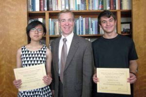From left: South High NCTE winners Yiqing (Elissa) He and Benjamin Newman flank English Department Head Dr. David Manuel.