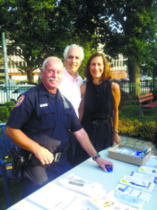 From left: A member of the Nassau County Police Department, Village of Great Neck Justice Mark Birnbaum and Nassau County Legislator Ellen W. Birnbaum at a past National Night Out
