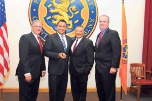 From left: Nassau County Executive Ed Mangano; Nassau County Police Department Chaplain Reverend Derek Garcia; Reverend Salvatore Garcia, Reverend Derek Garcia's father; and Acting Police Commissioner Thomas Krumpter