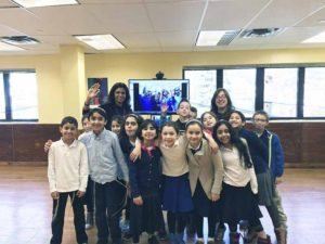 Fourth-grade SHA students Skyping with Kfar Yeladim David, a home for disadvantaged children in Israel.