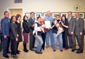 From left: Public Safety Commissioner Andrew DeMartin, Councilwoman Viviana Russell, Councilwoman Lee Seeman, Councilwoman Dina De Giorgio, Town Clerk Wayne Wink, Animal Shelter Director Jenna Givargidze with a Maltese named Benji, Supervisor Judi Bosworth, President of the Shelter Connection Dr. Bob Slifkin, Susan Hassett with a Beagle named Keeper, Councilwoman Anna Kaplan, Receiver of Taxes Charles Berman and Councilman Peter Zuckerman