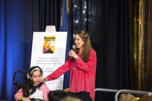 Chilina performing at the Reach for a Star Luncheon with Beste, a student at Henry Viscardi School at The Viscardi Center