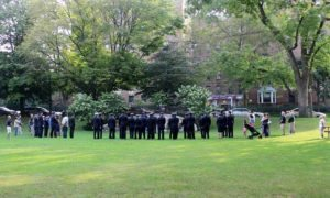 A crowd gathered for the early Sunday memorial service. (Photos by Michele Siegel)