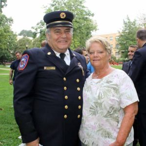 Jonathan Ielpi's mother, Anne, who worked for the Great Neck Park District for 29 years, stands with Park District Commissioner Robert A. Lincoln, Jr., in his Vigilant uniform.